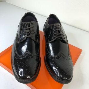 Bar III pattern leather wing tips